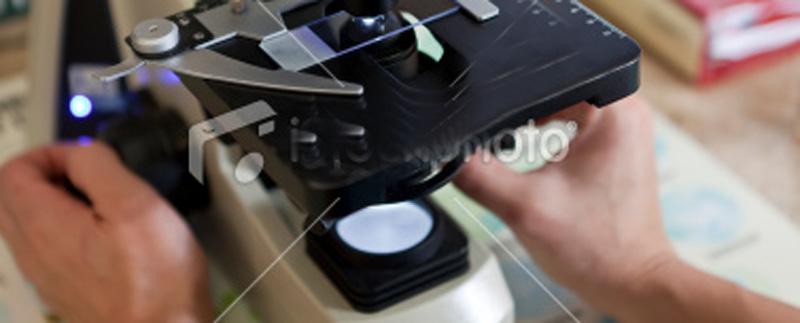 stock-photo-15603702-scientific-testing-underway-using-high-powered-microscope